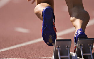 A runner starts off running.
