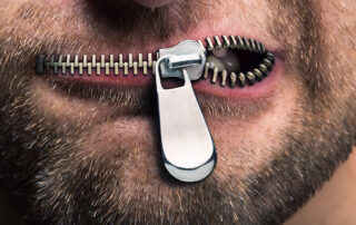 A close up image of a zipper effect across a person's mouth.