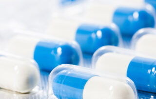 Blue and white capsules.